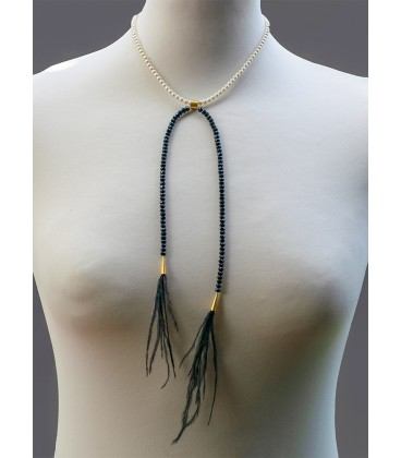 Elegant beaded necklace with ostrich feather.