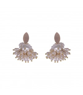Delicate pearl earrings.