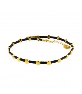 Leather choker with gold plated elements.