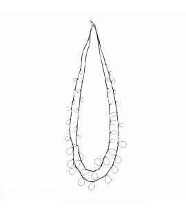Long faux leather necklace with silver plated drops.